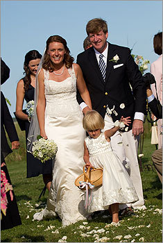 Patrick Kennedy and Amy Petitgout were married July 15 at the Kennedy compound in Hyannis Port. Left: Husband and wife walked down the aisle behind flower girl Harper Petitgout, Amy's daughter, after saying their vows. Read more in Names