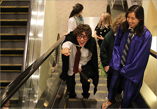 Hundreds streamed into AMC Loews Boston Common on Thursday night for the midnight premiere of the final Harry Potter movie, 'Harry Potter and the Deathly Hallows Part 2.' Anna Redgrave, left, of Brookline dressed as Harry Potter with Deirdre Quillen, dressed as Cho Chang, and Rikki Mueller, dressed as Neville Longbottom, background, arrived three hours early.