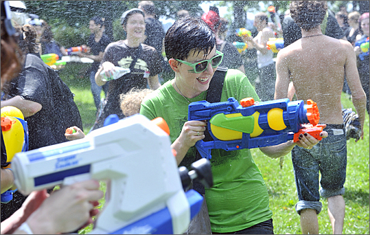 Participants in the Banditos Misteriosos 4th Annual Water Gun Fight on the Esplanade.