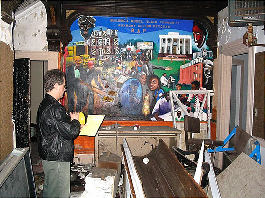 "Historic Boston, Inc. said in an e-mail newsletter recently, ""On the foyer wall, the group left a vibrant mural that features many neighborhood landmarks, including the Kittredge House, Kittredge Park and the nearby Alvah Kittredge Park Rowhouses. The painter is unknown, but the mural illustrates the state of the neighborhood at the time. The Alvah Kittredge Park Row Houses, a rehabilitation project completed by HBI in 2002, is shown as a boarded up and deteriorated set of four townhouses, and the Kittredge House gleams a vibrant white with an intact colonnade."