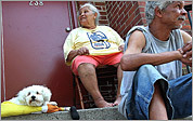 In Dorchester, Andrew Rosario, right, and his mother, Maria, tried to keep cool on their front stoop with their dog, Timmy.
