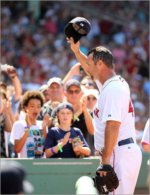 July 24: Red Sox 12, Mariners 8: Tim Wakefield tipped his cap after recording his 2,000th career strikeout in a Red Sox uniform. Wakefield earned his 199th career win Sunday despite allowing seven runs.