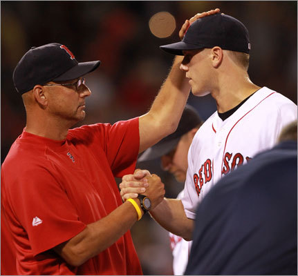 July 23: Red Sox 3, Mariners 1: Jonathan Papelbon (right) closed out the game, giving Terry Francona (left) his 1,000th win as a manager.