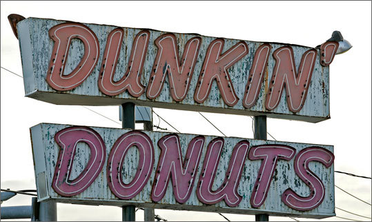 By 1963, the 100th restaurant in the chain opened. Munchkins were released in 1972, and muffins were added to the menu in 1978. A year later, the 1,000th franchise opened. Left: An old Dunkin' Donuts sign in Allston in 2007. It was one of the last remaining ones in that style.