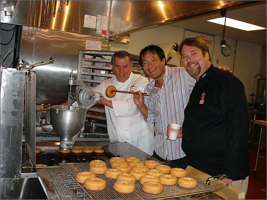 Dunkin' Donuts' headquarters moved to Canton in 2004. Left: Dunkin' Donuts culinary technologist Bob Pitts, chef Ming Tsai, and Dunkin' Donuts executive chef Stan Frankenthaler at the Canton facility in 2006.