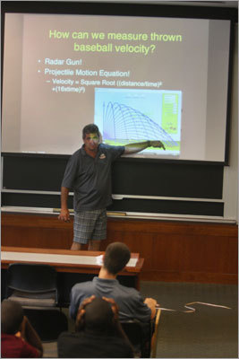 Andy Andres, head coach and program director of MIT's Science of Baseball, talked about projectile motion in a morning class. Andres explained how science and baseball are connected, but a different language is used. 'When on a baseball field have you ever heard somebody yell 'moment of inertia' and people know what you mean?' said Andres, with a laugh.