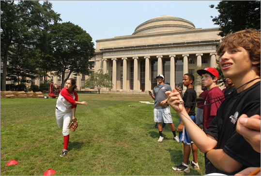 Inner-city boys in 8th and 9th grade participate in MIT's Science of Baseball program, which encourages students to learn baseball-related math and physics each morning and then apply those principles on the ballfield in the afternoon. Globe reporter/photographer Stan Grossfeld was at the scene. Jackie Atkins (left) of Baseball For All and boys participating in MIT's Science of Baseball conducted joint tests on projectile motion on Killian Court at MIT.