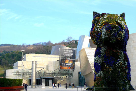 Jeff Koons' ''Puppy'' topiary sculpture proved so popular that Guggenheim Bilbao curators did not remove it as planned.