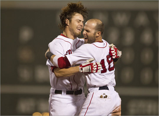Aug. 7: Red Sox 3, Yankees 2 (F/10) Dustin Pedroia (right) celebrated with Josh Reddick after his game-winning hit. Pedroia sent the game into extras with his sacrifice fly in the ninth, scoring Marco Scutaro.