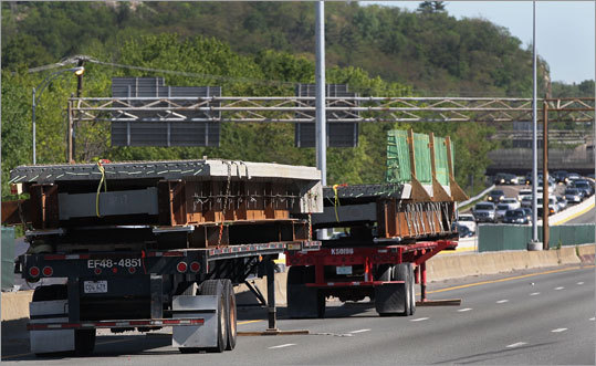 Construction materials (left) for bridge repairs sit on a truck on Interstate 93 northbound in Medford. The state Department of Transportation had intended to put off the Medford construction for a few more years. But during a routine paving project last August, a couple of gashes large enough to swallow a car emerged, causing hours-long delays for tens of thousands of motorists, and revealing more decay than expected in the steel and concrete below the asphalt. The state accelerated plans to replace the bridges that carry the highway over local roads in Medford; the new spans are expected to last 75 years.