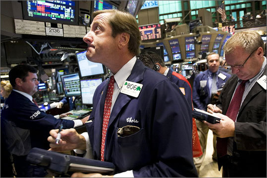 Aug. 8 Dow dropped 634.76 in one day to 10,809.85. Read more Left: Traders on the floor of the New York Stock Exchange.