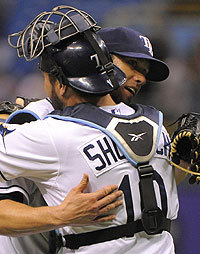 Rays pitcher James Shields gets a hug from Kelly Shoppach after throwing a six-hit shutout against the Royals.