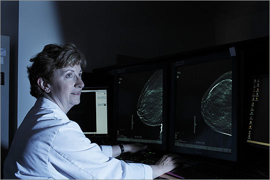 DIGITAL REVOLUTION Dr. Elizabeth Rafferty, a radiologist at Boston's Massachusetts General Hospital, performs a mammogram using Hologic's new 3-D Selenia system.