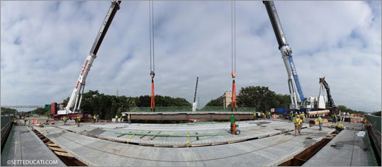 A 10-part panoramic image (left) shows the last deck panel being placed via a tandem lift with two 600-ton mobile cranes. The Valley Street Bridge over the Fellsway in Medford contained some of the largest and longest deck panels on the Fast 14 project. Here the final piece, almost 85 feet long and weighing 121,500 pounds, is slowly lowered into place.
