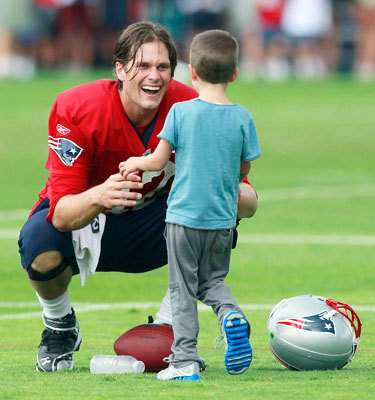 Aug. 9 Tom Brady greets his son Jack on the field after practice in Foxborough.