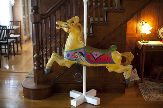'The house when I bought it was horribly run down,'' Davis said. 'I spent about three years restoring it, fixing the walls, painting it, doing little repairs to it. But basically, it was pristine and hadn't ever been butchered. The windows are all original.'' This 1906 Parker Carousel Horse is on display in the living room.