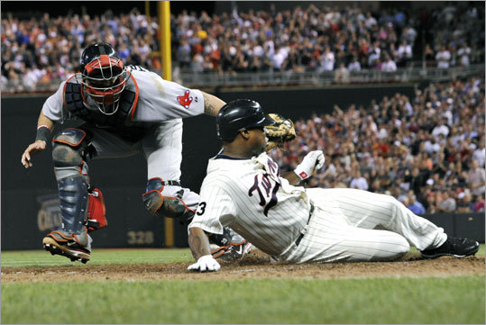 Red Sox catcher Jarrod Saltalamacchia prevented Delmon Young from scoring in the eighth inning, but couldn't prevent a loss in Boston's series finale at Minnesota. The Twins scored three times in the eighth to gain a 5-2 victory.