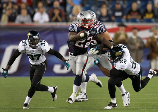 Patriots running back Stevan Ridley stiff armed Jaguars cornerback Don Carey as he broke loose for a long gain in the second half. In addition to his two rushing touchdowns, Ridley had a receiving touchdown and caught seven passes for 47 yards.