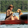 Erika Conklin of Salem and her dog King Louis paddled along Flax Pond in Brewster.