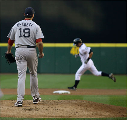 Aug. 13: Mariners 5, Red Sox 4 Beckett got off to a bad start right from the first pitch, giving up a solo home run to Ichiro Suzuki (pictured, rear). Seattle scored five runs in the first inning. Beckett ended up going five innings in the game and did not give up another run.