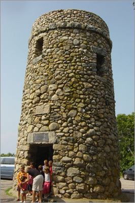 Scargo Tower A curious cobblestone tower rises 30 feet on Dennis's highest hilltop, above Scargo Lake. Dating from 1901, it features a 37-step spiral staircase to an outdoor observation deck, with views of Provincetown and the mainland spread below. Children enjoy the legend of Princess Scargo, the Indian maiden who shed abundant tears for her treasured pet fish who lay dying in a summer drought. Her tears are said to have formed the lake, reviving two of the fish and spawning their silvery descendants today. Scargo Hill Road