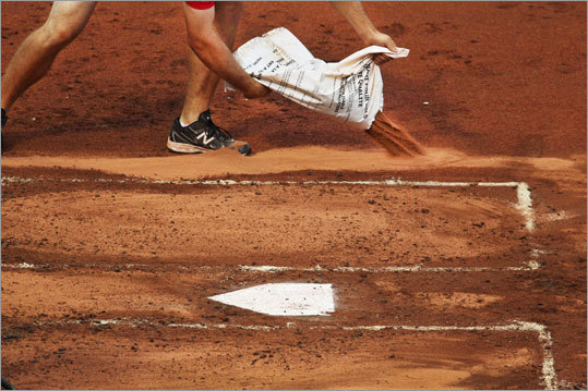 Head groundskeeper David Mellor says that during one day game played amid torrential rain this year his crew dumped 8,000 pounds of clay on the field to try and keep up with the moisture. 'We order 10 tons at a time. The batting box is top dressed with 1/4 inch or up to 3/8 or 1/2 inch if it rains. It's calcined clay heated. Ours is baked in oven at over 18,000 degrees. It's Turface. We use two sizes. Proline is a finer material. It's like fine sand -- holds the moisture in and keeps it from drying out.""