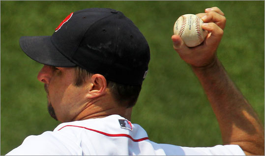 "Red Sox pitcher Tim Wakefield throws a knuckleball during a game at Fenway Park, making sure not to let his fingertips touch the baseball's stitches. 'I feel like if it's on the seams it's going to catch and tumble out of my hand. I just hold it like that and throw it and pray. When there's not a lot of humidity here, the balls that are rubbed up feel like they've got baby powder on them because the moisture hasn't taken into the leather yet. Its very slippery, you've got to get some moisture on it. ""I manicure my nails myself, every other day with an emery board."""