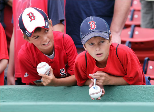 Aug. 16, Game 1: Red Sox 3, Rays 1 Two young fans sought an autograph prior to the start of the doubleheader at Fenway Park.