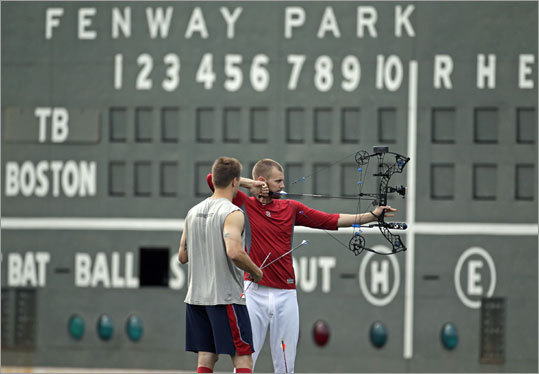 Aug. 16, Game 1: Red Sox 3, Rays 1 Daniel Bard (right) took some archery shots in between games of the doubleheader.