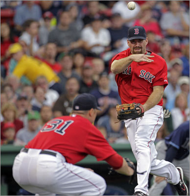 Aug. 16, Game 1: Red Sox 3, Rays 1 Rays catcher Kelly Shoppach surprised Red Sox third baseman Kevin Youkilis with a bunt in the second inning. Youkilis charged and fired to first (as pitcher Jon Lester ducked out of the way), but Shoppach was called safe on a close play at first.