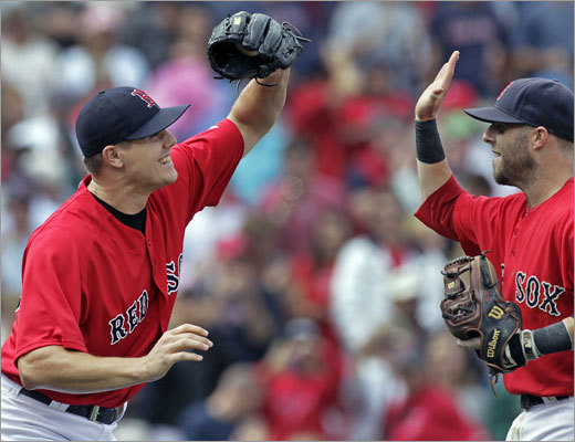 Aug. 16, Game 1: Red Sox 3, Rays 1 Jonathan Papelbon (left) and Dustin Pedroia celebrated after Pedroia snared a liner to end the game. Papelbon picked up his 28th save.