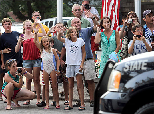 A crowd waved as the presidential motorcade passed by Alley's General Store.