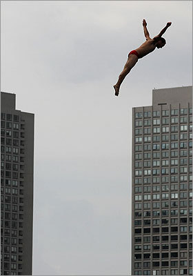 Diver Kent De Mond from the United States dived against the backdrop of the Harbor Towers.