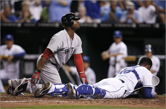 Aug. 18: Red Sox 4, Royals 3 Sox left fielder Carl Crawford steamrolled Royals catcher Salvador Perez but was tagged out after a perfect throw from center fielder Melky Cabrera in the fourth inning. Mike Aviles, a former Royal, flied out to center.