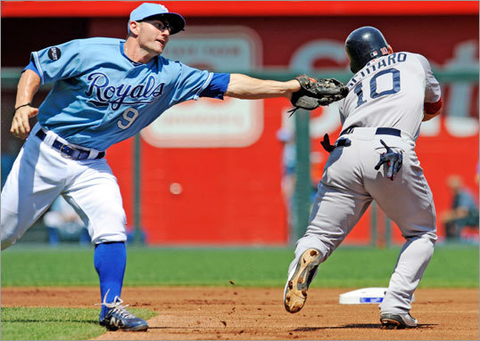 Aug. 21: Red Sox 6, Royals 1 Red Sox shortstop Marco Scutaro got caught between bases and was tagged out by Royals second baseman Johnny Giavotella in the first inning.