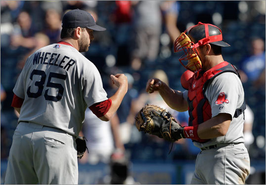 Aug. 21: Red Sox 6, Royals 1 Red Sox reliever Dan Wheeler bumped fists with Sox catcher Jason Varitek following Boston's 6-1 victory over the Royals Sunday afternoon.