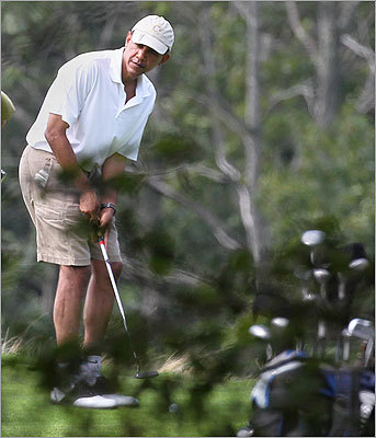 The president prepared to putt during a round of golf at the Vineyard Golf Club in Edgartown on Aug. 21.