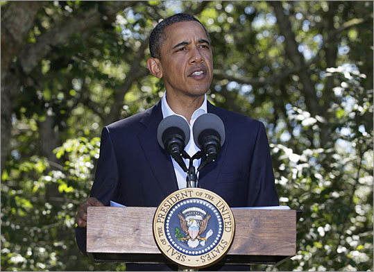 President Obama took a break from his vacation to address the press on the Libya issue at Blue Heron Farm in Chilmark on Aug. 22. Obama said Moammar Khadafy's 42-year rule is coming to an end, but warned that fighting in Libya was 'not yet over.'