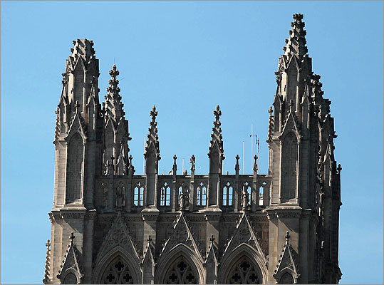 One of the spires, left, of the National Cathedral in Washington was missing following the quake.