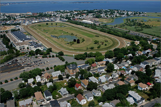 Richard Fields of Suffolk Downs Executives at Suffolk Downs previously said their plans to build a resort casino would bring business to East Boston, Revere, and surrounding communities. Fields has also developed resort casinos in Hollywood and Tampa, Fla. Left: Suffolk Downs in East Boston.