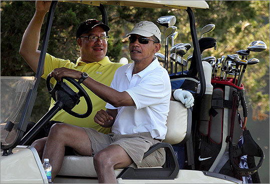 Events have eroded support for President Obama, golfing with Eric Whitaker during his third summer stay on the Vineyard.