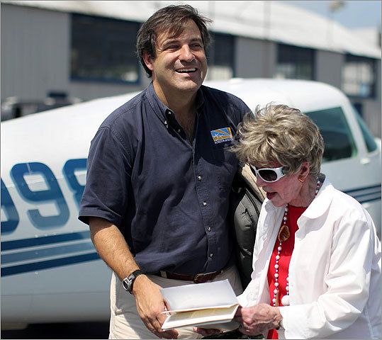 "Zeke Valtz (left) President of Horizon Aviation, who served as her instructor for the lift, talking with Malley (right) after the flight. ""We get a lot of calls to celebrate a special occasion,'' Valtz said. ""But this one is unique. To have someone celebrate a 90th birthday is amazing.''"