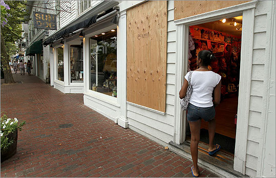 Raquel Leiba, 31, of Jamaica, walked into Sheila Allen-Styles, which had boarded up its windows, in Edgartown on Martha's Vineyard. 'I heard that it's not as strong as the hurricanes in Jamaica that we're used to,' Leiba said.