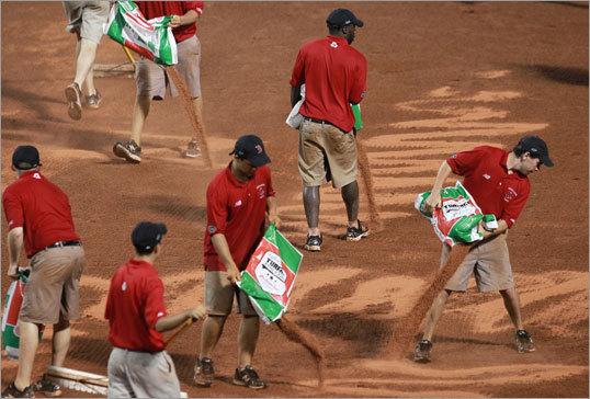 Sat. Game 1: Red Sox 9, A's 3 The Fenway Park grounds crew worked to keep the field dry. The Red Sox put up plenty of support for Jon Lester to win the first game/