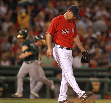 Friday: Athletics 15, Red Sox 5 Tim Wakefield started Friday night's game looking for his 200th career win. Wakefield ran into trouble Friday night, giving up six runs in the fourth inning. Here, Oakland's Scott Sizemore (rear) hit a two-run home run off Wakefield.