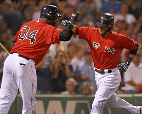 Friday: Athletics 15, Red Sox 5 The Red Sox made their only charge of the game in the fourth inning. Dustin Pedroia (right) hit the first of back-to-back home runs and was congratulated at home by David Ortiz.