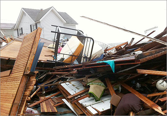 20 beach homes were destroyed by surf churned by Tropical Storm Irene along the shore of Long Island Sound in East Haven, Conn.