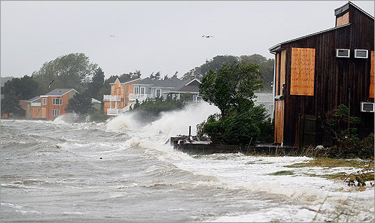 From North Carolina to New Jersey, Hurricane Irene's winds and storm surge fell short of the doomsday predictions. But the storm left several dead before reaching New England in its wake, lashed North Carolina with ferocious winds and triggering emergency steps including unprecedented evacuations and transit shutdowns in New York. Waves crashed around homes as Hurricane Irene arrived in Hampton Bays, N.Y.