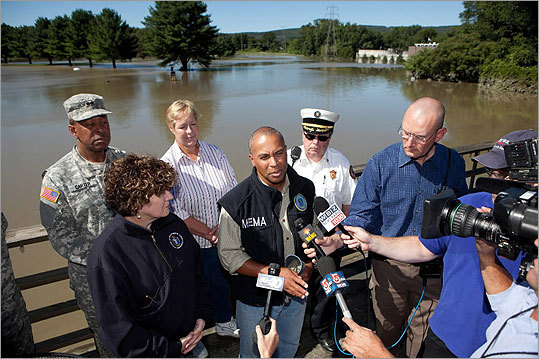 Surrounded by local officials, Governor Deval Patrick spoke to the media in Greenfield during a tour on Monday to assess the damage from the storm.