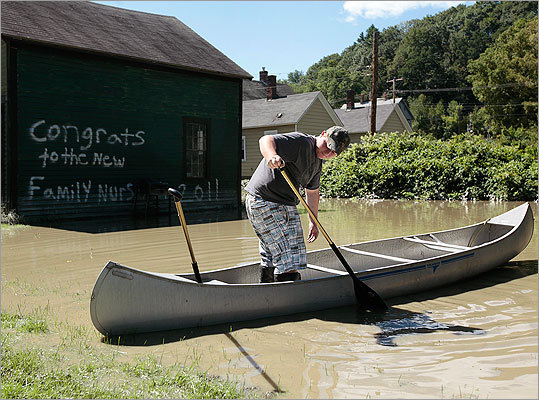Devin Isaacs floated in standing water that has accumulated where a grassy field used to be in his neighborhood in White River Junction, Vt.
